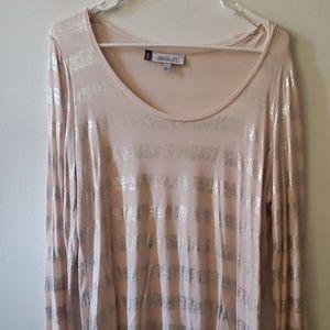 A long sleeve low nexk silver shiny shirt